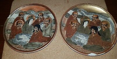 Pair of Japanese Meiji period plates decorated with gods