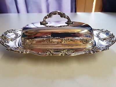 A Vintage Silver Plated Butter Dish With Beautiful decorated patterns.
