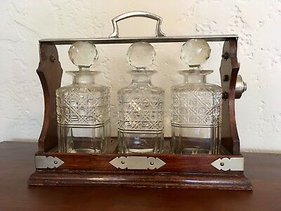 Victorian English Oak and Metal Tantalus Set Crystal Decanters