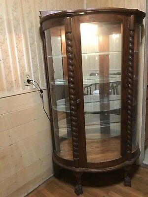 Antique bow front claw foot china cabinet Glass Shelves And Mirror Back  RARE