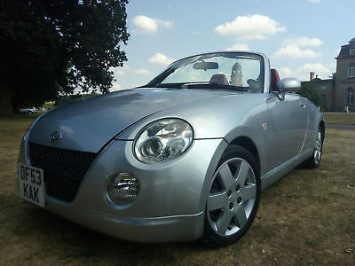 2004 Daihatsu Copen 659 cc in silver with red leather interior