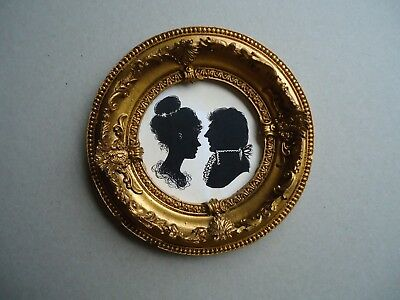 Pair  Of  Silhouettes  In  A  Round  Gilt  Frame