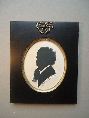 Silhouette  Of  Charles  Dickens  In  A  Ribbon  Frame