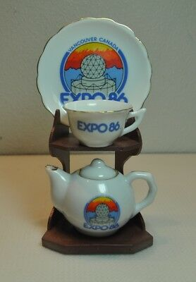 4 Piece Miniature Expo 86 Teacup, Saucer, Creamer Dish and Display Stand