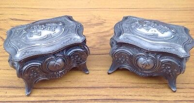 A pair of metal Pewter Effect trinket boxes with decorative