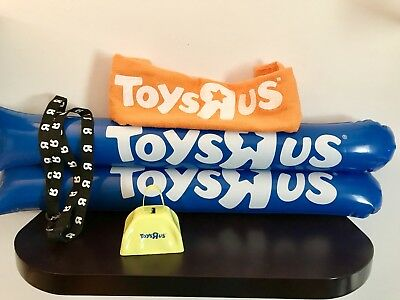 Toys R Us collectors items- set of bang sticks, lanyard, cow bell and towel