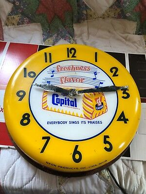 capital bakers inc neon products inc metal clock