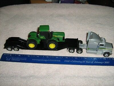 Ertl 1/64 scale John Deere Toy Tractor With Semi and Lowboy Flatbed Trailer