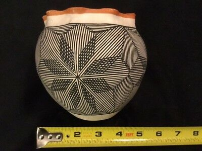 Hand coiled small Acoma Pueblo pot by S. Phillips
