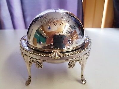 a beautiful vintage silver plated butter dish wirh hand engraved patterns.