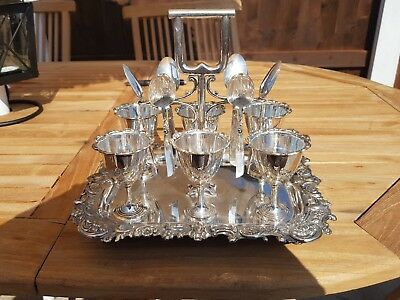 An Antique Silver Plated 6 Egg Cup & spoon Set By thomas latham & ernest morton.