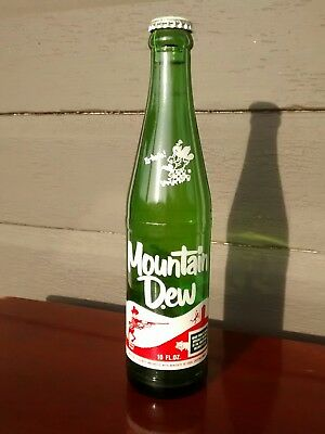"VINTAGE  MOUNTAIN DEW HILLBILLY SODA BOTTLE MT. DEW  BOTTLE 10oz.""Laughing pig"""