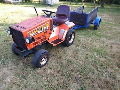 Kubota diesel compact tractor with trailer and mower