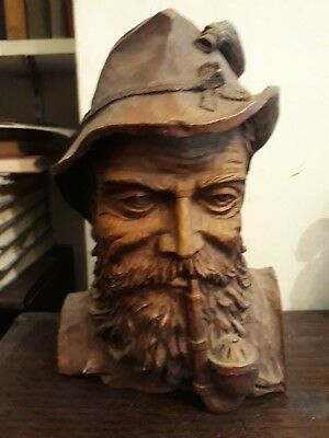 Decorative black forest man's head smoking pipe