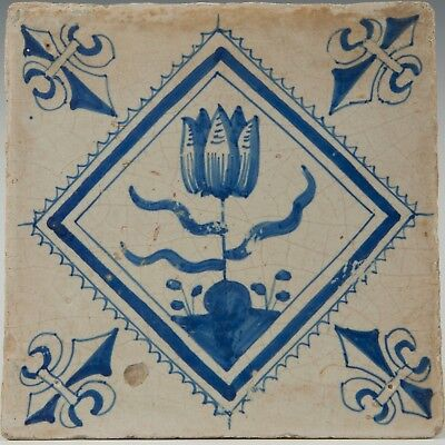 Nice Dutch Delft Blue tile, tulip, tulip in blue diamond, 17th century.