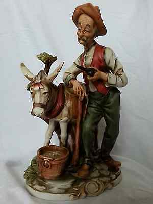 Napcoware Porcellane D'Arte Figurine Man with Donkey