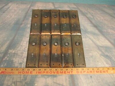 5 pairs of vintage door knob back plates copper and black