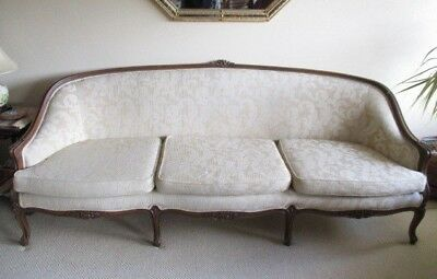 Classic chesterfield sofa originally from USA  solid carved wood surrounds