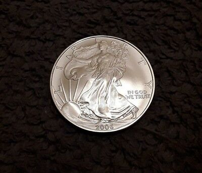2006 USA,1OZ FINE SILVER EAGLE DOLLAR $1 COIN in sleeve.