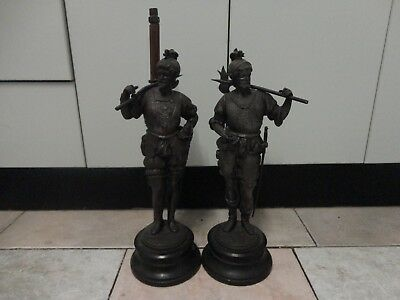 A pair of antique spelter figures/statues