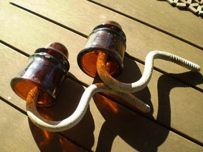 Collectable Vintage glass electrical insulators 2 amber with brackets Free post