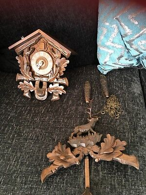 German Cuckoo Clock need to put chain and weights in instructions included