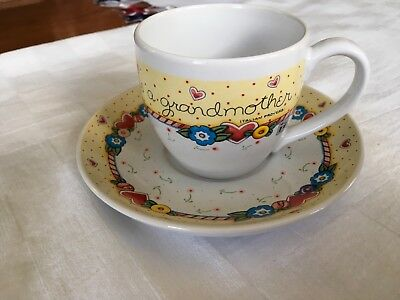 """Mary Engelbreit Tea Cup And Saucer, """"When a Child is Born so is a Grandmother"""""""