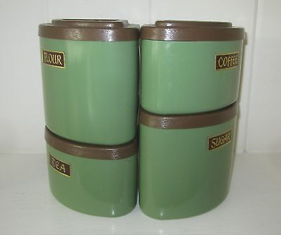 4 Vintage Stackable Avocado Green Metal Canisters with Brown Wood Grain Lids