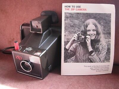 zip polaroid land camera with instruction booklet (batteries not included)