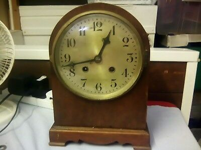 vintage stricking mantle clock with pendulum and key