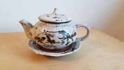 Japanese clay teapot with saucer