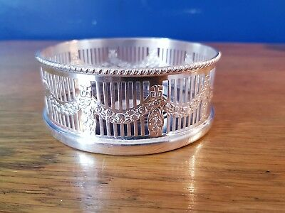 A Beautiful Vintage Silver Plated Wine Bottle Coaster with elegant patterns