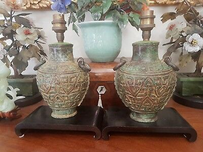 Pair of vintage bronze urn lamps on wooden bases