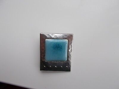 Arts and Crafts Ruskin turquoise cabouchon and hand wrought white metal brooch