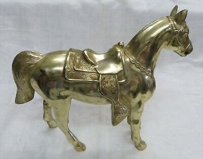Vintage metal horse, about 14 by 11 inches, gold tone, used