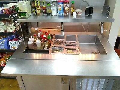 Refrigerated Salad/Salsa/Condiments Bar.