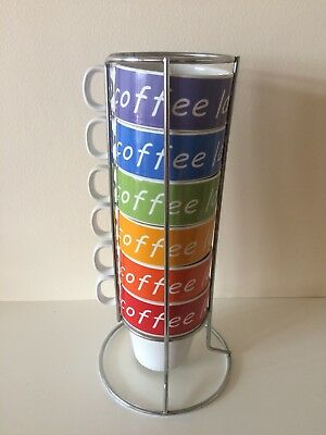 Set of 6 Coffee Cups in a Stainless Steel Holder.