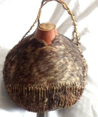 Old Water vessel water bowl fur and rope very interesting might be African ???