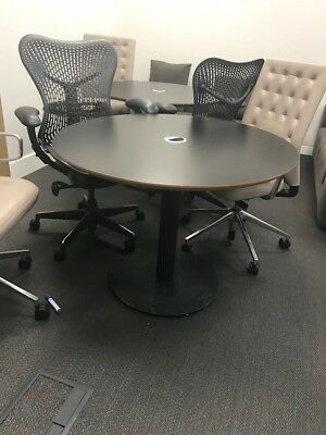 Black meeting room table, circle, good condition. port to hide cables.