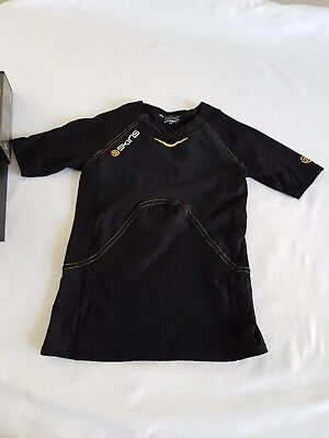 Genuine Skins - A 400-Youth short sleeve top black Size-YL. Still with box.