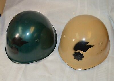 Two Vintage Italian World War II Helmets