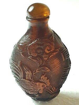 An Exquisite finely Carved 19th C Qing Dynasty Amber snuff bottle. Signed.