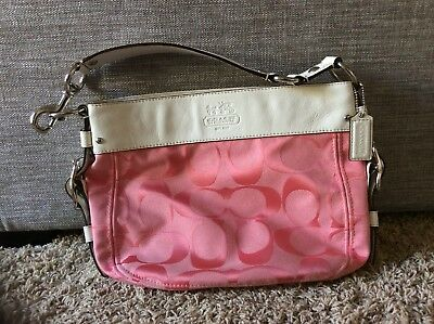 Pink Canvas Coach Logo Purse With White Leather Handle And Embellishments