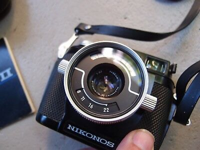 Nikonos II underwater film camera with accessories and brochure