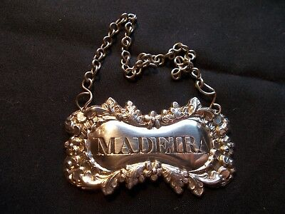 """A Victorian engraved silver """"MADEIRA"""" wine decanter label"""