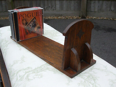 Antique oak book stand, Arts and Crafts period, good quality, ideal for CDs etc