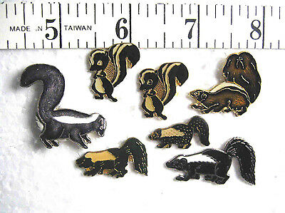 13 Assorted enameled Skunk related Stick Pins