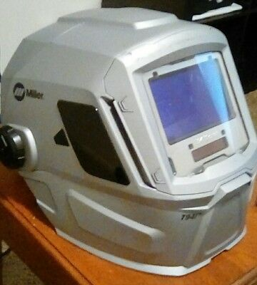 Miller t94i auto weld hood. silver used shades 8-13 very very good condition!