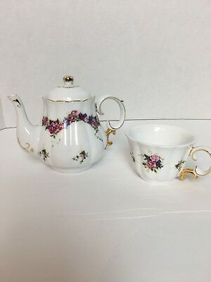 Dainty Floral Teapot And Tea Cup Set