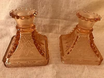 Depression glass candlestick holders in beautiful amber color!!  Matching pair!